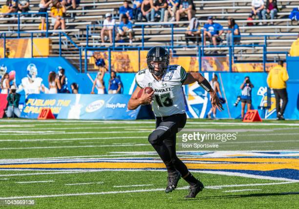 Hawaii Warriors quarterback Cole McDonald takes a quarterback option to run during the game between the Hawaii Warriors and the San Jose State...