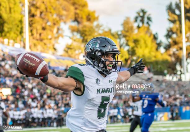 Hawaii Warriors wide receiver John Ursua celebrates the 1st Hawaii Warriors touchdown of the game between the Hawaii Warriors and the San Jose State...