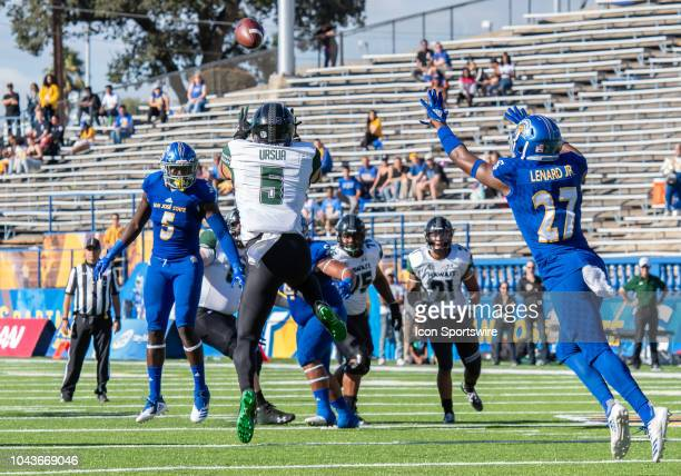 Hawaii Warriors wide receiver John Ursua goes up for a pass in front of San Jose State Spartans safety Jonathan Lenard Jr during the game between the...