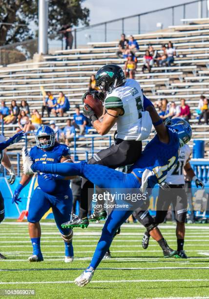 Hawaii Warriors wide receiver John Ursua holds onto a pass while San Jose State Spartans safety Jonathan Lenard Jr pulls him down during the game...