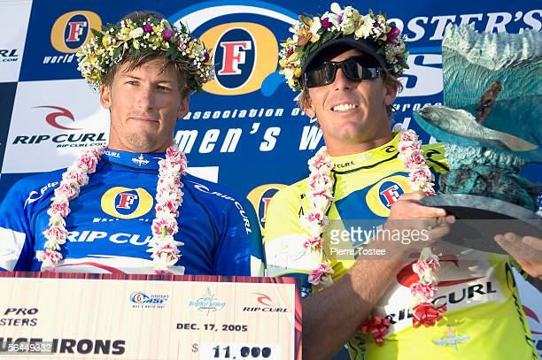 Hawaiian Andy Irons poses with younger brother Bruce Irons after the final of the Rip Curl Pro Pipeline Masters ASP World Tour event part of the Vans...