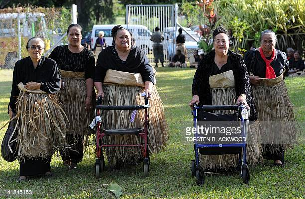 Hawaiian elders dressed in black and wearing the traditional ta'ovala waistmats arrive to pay their respects to Queen Halaevala Mata'aho the mother...