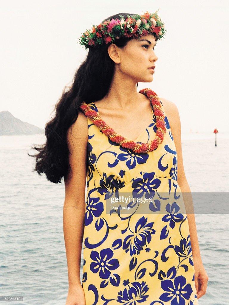 Hawaiian female wearing traditional hula attire. : Stock Photo