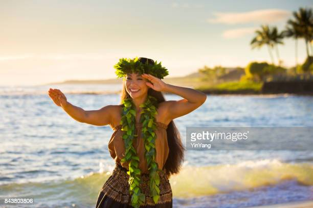 hawaiian hula dancer dancing on the beach of kauai hawaii - beautiful polynesian women stock photos and pictures