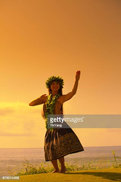 hawaiian hula dancer dancing on the beach - hula dancer stock pictures, royalty-free photos & images