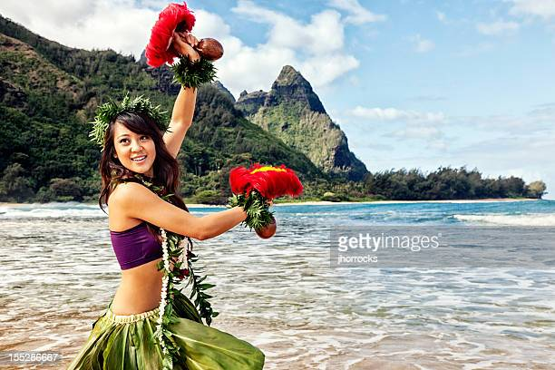 Hawaiian Hula Dancer on Beach with Red Feather Shakers