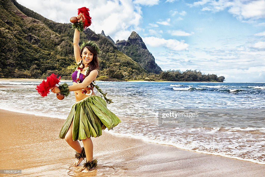 Hawaiian Hula Dancer On Beach With Red Feather Shakers Stock Photo - Getty Images-4306