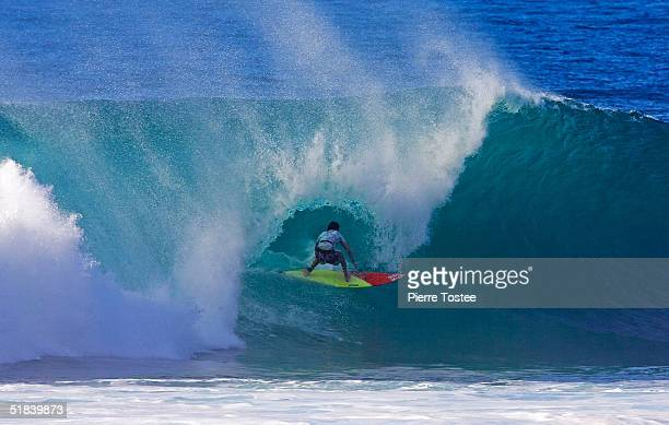 Hawaiian Mikey Bruneau competes in the Rip Curl Pipe Masters on December 8 2004 at Pipeline of the North Shore of Oahu Hawaii