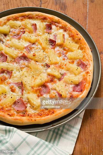 hawaiian pizza with ham and pineapple - hawaiian pizza stock pictures, royalty-free photos & images