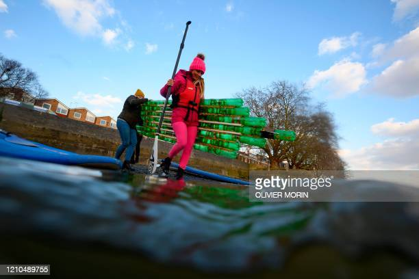 Hawaiian protest surfer Alison Teal arrives with a stand up paddle made of used plastic bottles to collect trash on the River Thames near Kew Bridge...