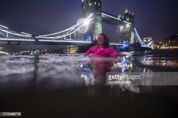 Hawaiian protest surfer Alison Teal paddles in the River Thames on her surfboard during a visit to London on March 5 to raise awareness on the need...