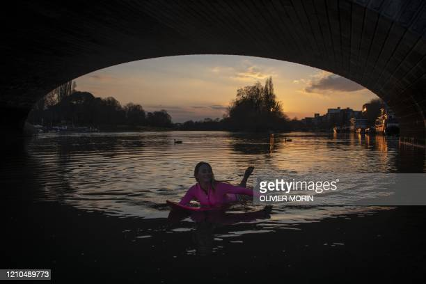 Hawaiian protest surfer Alison Teal paddles under Kew Bridge on the River Thames during a visit to London on March 6 to raise awareness on the need...