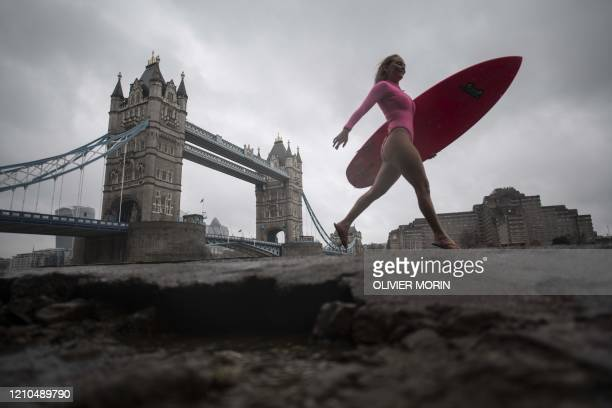 Hawaiian protest surfer Alison Teal walks along the river Thames near Tower Bridge during a visit to London on March 5 2020 to raise awareness on the...