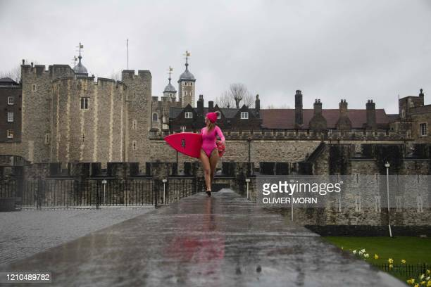 Hawaiian protest surfer Alison Teal walks along the Tower of London during a visit to London on March 5 2020 to raise awareness on the need to combat...