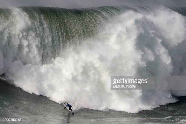 TOPSHOT Hawaiian surfer Kai Lenny rides a wave during the big waves Nazare Tow Surfing Challenge in Nazare on February 11 2020