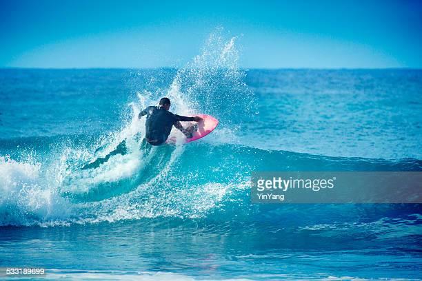 Hawaiian Surfer Surfing in Kauai
