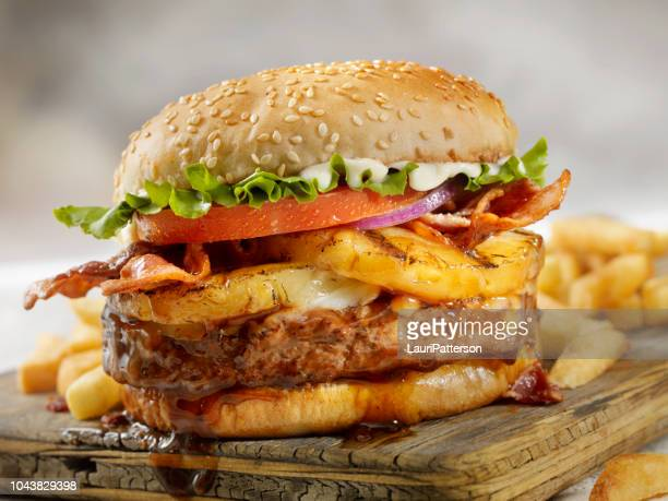 hawaiian teriyaki, pineapple and bacon burger with fries - hamburger stock pictures, royalty-free photos & images