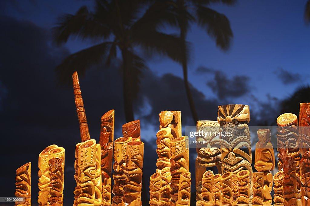 Hawaiian tiki mask art and blue palm tree sky. : Stock Photo