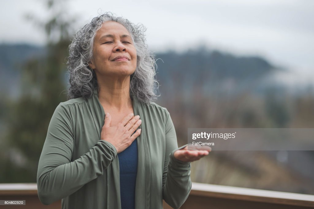 Hawaiian woman doing yoga pose outside : Stock Photo