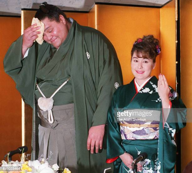 Hawaiian yokozuna Akebono wipes his face during an press conference announcing his engagement with Christiane Reiko Kalina on February 10 1998 in...