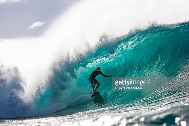 Hawaii's Flynn Novak surfs while practicing for Da Hui Backdoor shootout at the Pipeline Masters on Oahu's North Shore Hawaii on January 2 2019 The...