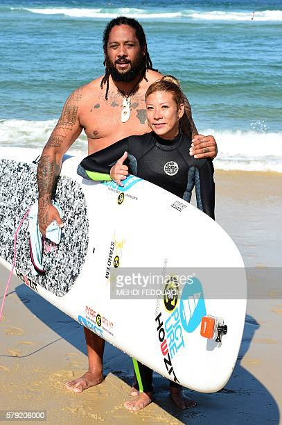 US Hawaii's Jordan Patterson and Angelee Homma pose aftering competing in the International Tandem Surfing Championship on July 23 2016 in...