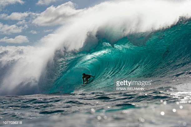 Hawaii's Kalani Baker surfs while practicing for Da Hui Backdoor shootout at the Pipeline Masters on Oahu's North Shore Hawaii on January 2 2019 The...