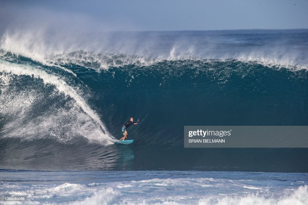 dad24cf919 Hawaii s pro surfer Flynn Novak surfs Banzai Pipeline ahead of the ...