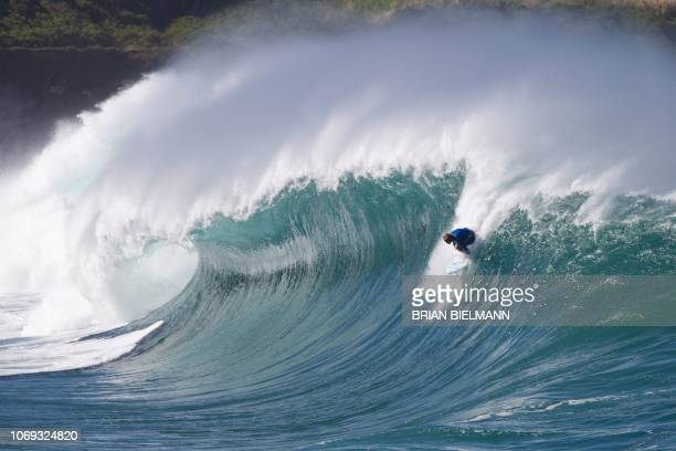 Hawaii's pro surfer Jamie O'Brien surfs Banzai Pipeline ahead of the Billabong Pipe Masters on the north shore of Oahu in Hawaii on December 6 2018 /...