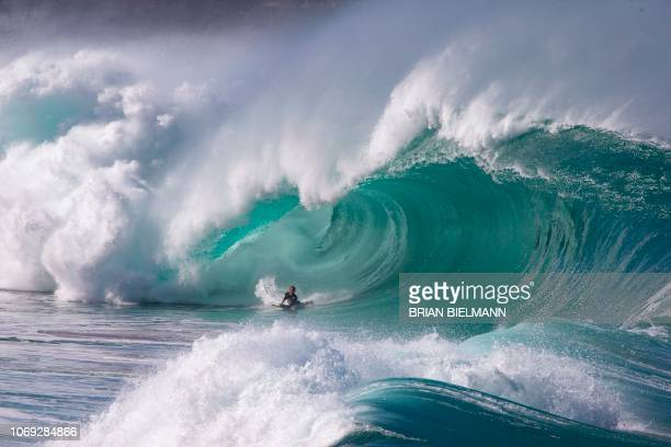 TOPSHOT Hawaii's pro surfer Kalani Chapman surfs Banzai Pipeline ahead of the Billabong Pipe Masters on the north shore of Oahu in Hawaii on December...