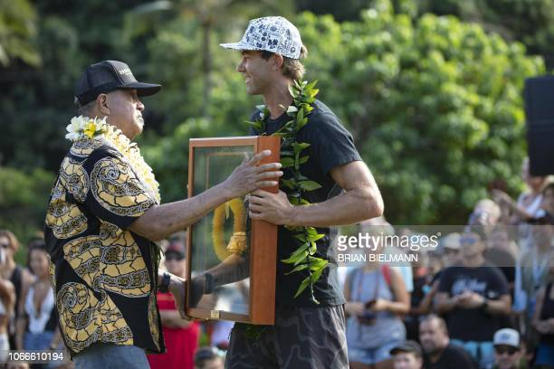 Hawaii's pro surfer Kohl Christensen and Clide Aikau brother of the late Eddie Aikau take part in the opening ceremony of the 2018 Eddie Aikau Big...