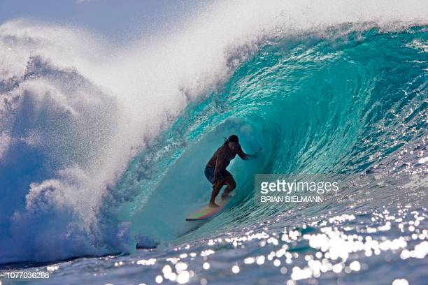 Hawaii's Tamayo Perry surfs while practicing for Da Hui Backdoor shootout at the Pipeline Masters on Oahu's North Shore Hawaii on January 2 2019 The...