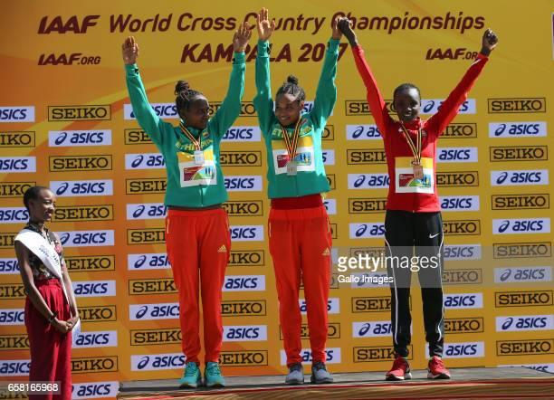 Hawi Feysa and Letesenbet Gidey of Ethiopia with Celliphine Chepteek Chespol of Kenya on the podium during the U20 women race of the 2017 Kampala...