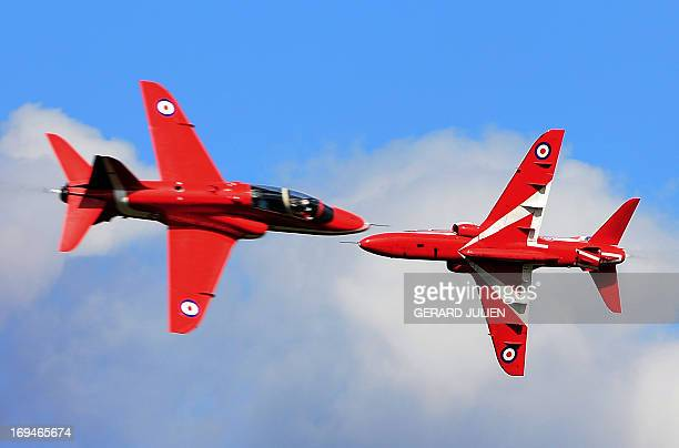 Hawk aircrafts from the British elite acrobatic flying team 'Red Arrows' fly over the 701 Air Base of SalondeProvence southern France on May 25 2013...