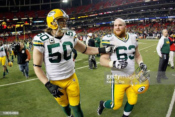 J Hawk and Scott Wells of the Green Bay Packers celebrate as they walk off the field after they won 4821 against the Atlanta Falcons during their...