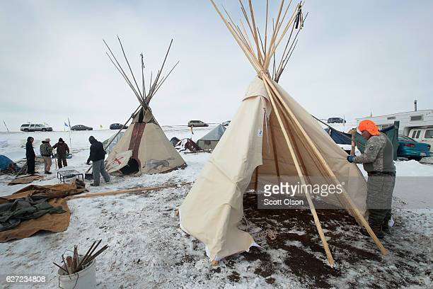 Hawk Laughing a Mohawk originally from northern New York helps to build a tipi at Oceti Sakowin Camp on the edge of the Standing Rock Sioux...