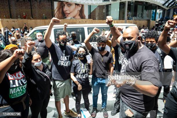 Hawk Newsome Chairperson of BLMNY holds a circle with his team with their arms raised up with a fist just before addressing the thousands of...