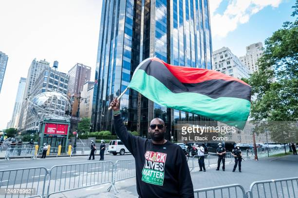 Hawk Newsome Chairperson of the Black Lives Matter Greater New York wears a Black Lives Matter sweater and holds a PanAfrican Black Liberation Flag...