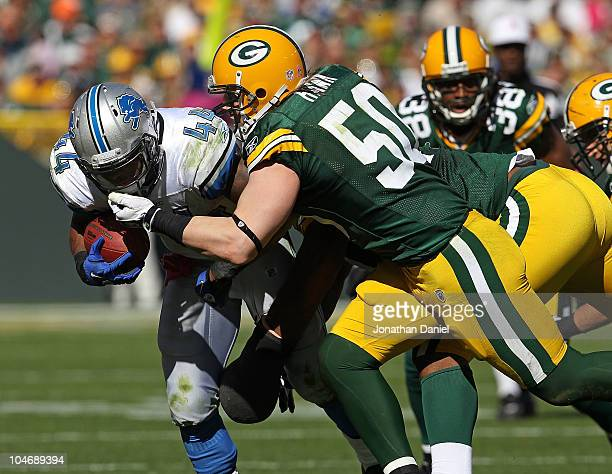 J Hawk of the Green Bay Packers grabs the face mask of Jahvid Best of the Detroit Lions resulting in a penalty at Lambeau Field on October 3 2010 in...
