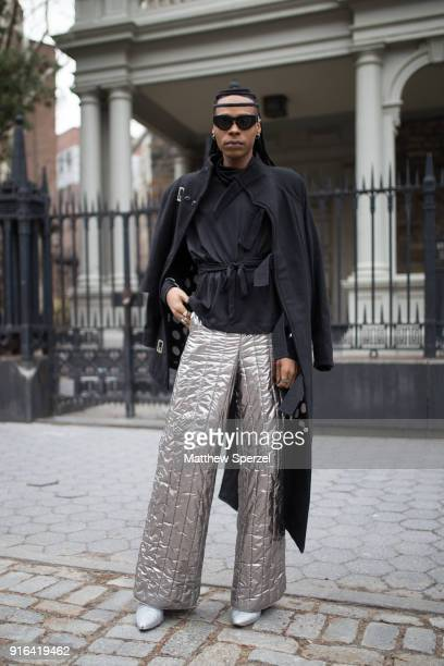 B Hawk Snipes is seen on the street attending Linder during New York Fashion Week wearing a black coat with silver metaillic pants on February 9 2018...