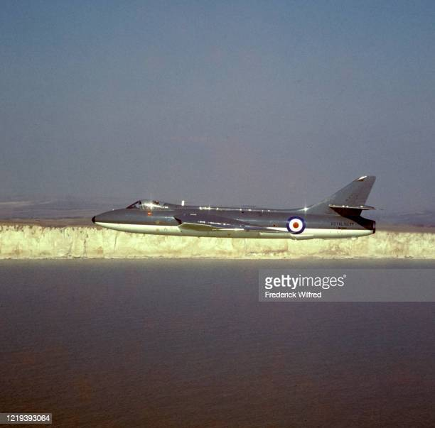 Hawker Hunter jet fighter of the Royal Navy's Fleet Air Arm flying along the white cliffs of Dover, UK, circa 1960.