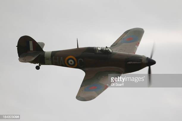 Hawker Hurricane Mk XIIa 5711 fighter aircraft performs an aerobatic display at the IWM Duxford on October 18 2012 in Duxford England The aeroplane...
