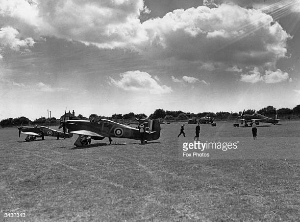 RAF pilots leaving their planes at Hawkinge Airport in Kent after a sortie during the Battle of Britain