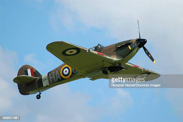 Hawker Hurricane World War II fighter plane of the Royal Air Force taking off from Duxford airport, England.