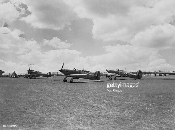 RAF Hawker Hurricanes N2458 and N2459 ready for takeoff at Hawkinge Airport in Kent during World War II July 1940