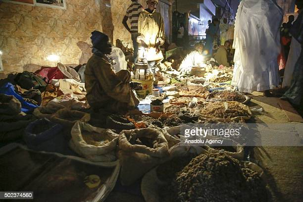 A hawker is seen as the people gather at the Serigne Mbaye Sy Mosque for the Mawlid al Nabi ceremony marking the birth of the Prophet Muhammad...