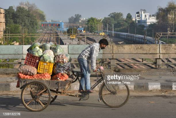 A hawker rides a cycle cart loaded with vegetables on day eleven of the 21day nationwide lockdown to curb the spread of coronavirus at Modi Mill...