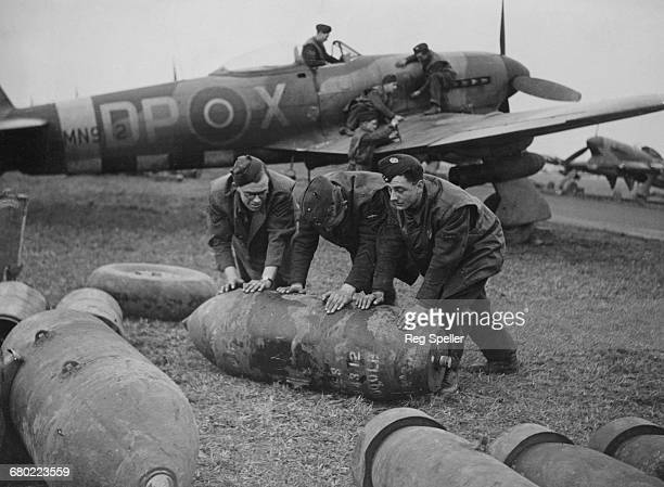 Hawker Typhoon Mk1b singleseat fighterbombers of No193 Squadron from 146 wing Second Tactical Air Force of the Royal Air Force are being re armed...