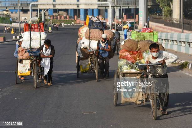 Hawkers pull cycle carts loaded with vegetables on day eleven of the 21day nationwide lockdown to curb the spread of coronavirus at Modi Mill flyover...