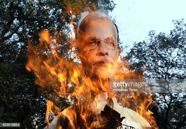 Hawkers Sangram Committee activists burning the effigy of Prime Minister Narendra Modi during a protest against demonetization on November 24 2016 in...